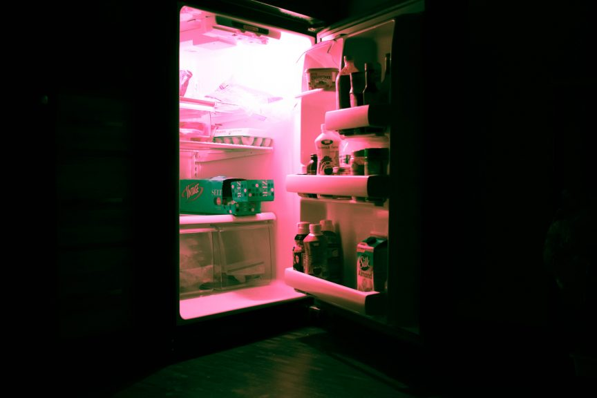 opened refrigerator filled with bottles