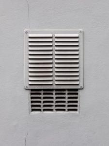 white metal window frame on white wall