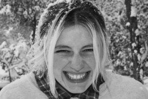 grayscale photo of woman smiling